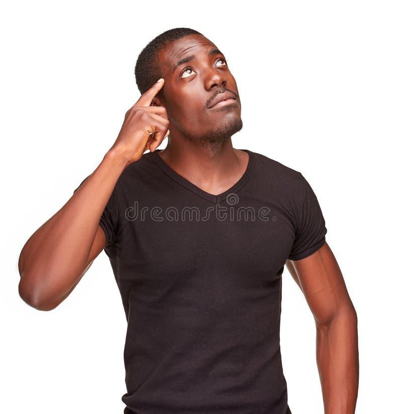 Homem novo do africano negro que pensa e que fala do passado imagem de stock royalty free