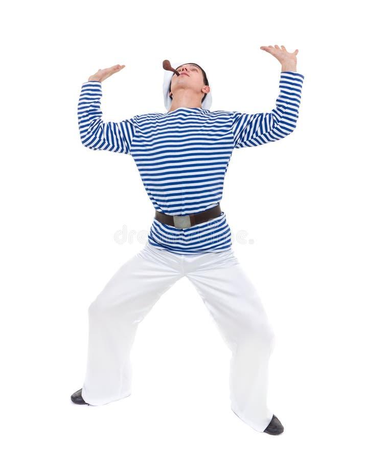 Homem novo do dançarino vestido como um marinheiro que levanta contra o branco isolado do comprimento completo fotos de stock royalty free