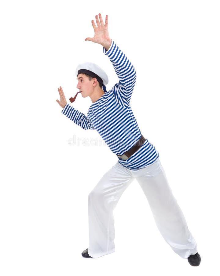 Homem novo do dançarino vestido como um marinheiro que levanta contra o branco isolado do comprimento completo foto de stock royalty free