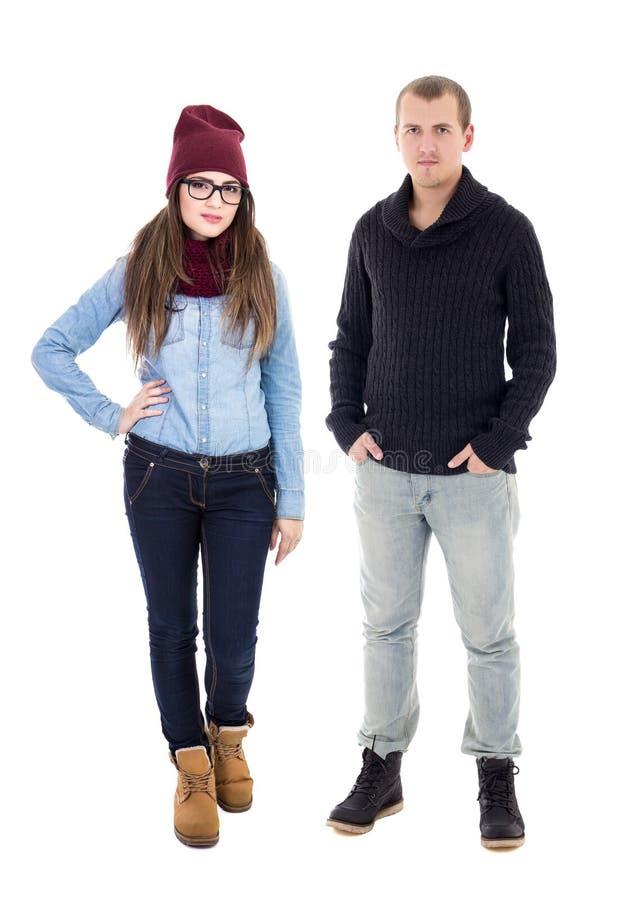 Homem novo e mulher na roupa do inverno isolada no branco imagem de stock royalty free
