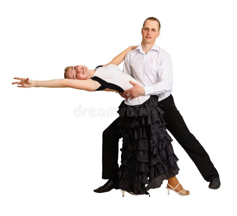 Homem novo e uma dança de salão de baile da dança da menina foto de stock royalty free