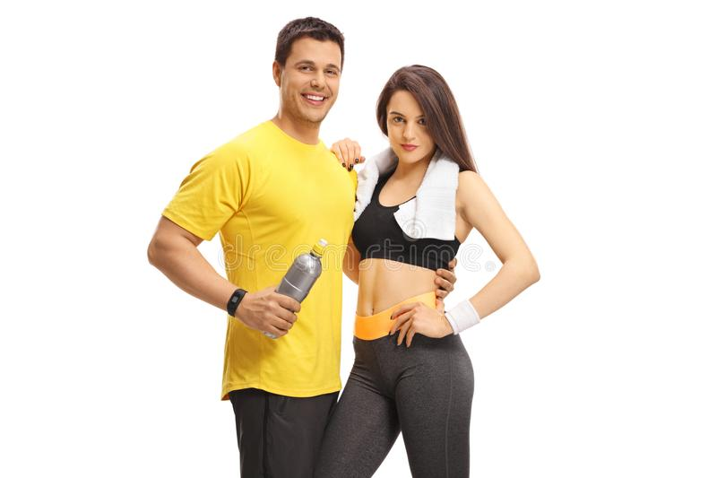 Homem novo e uma jovem mulher no sportswear imagem de stock royalty free
