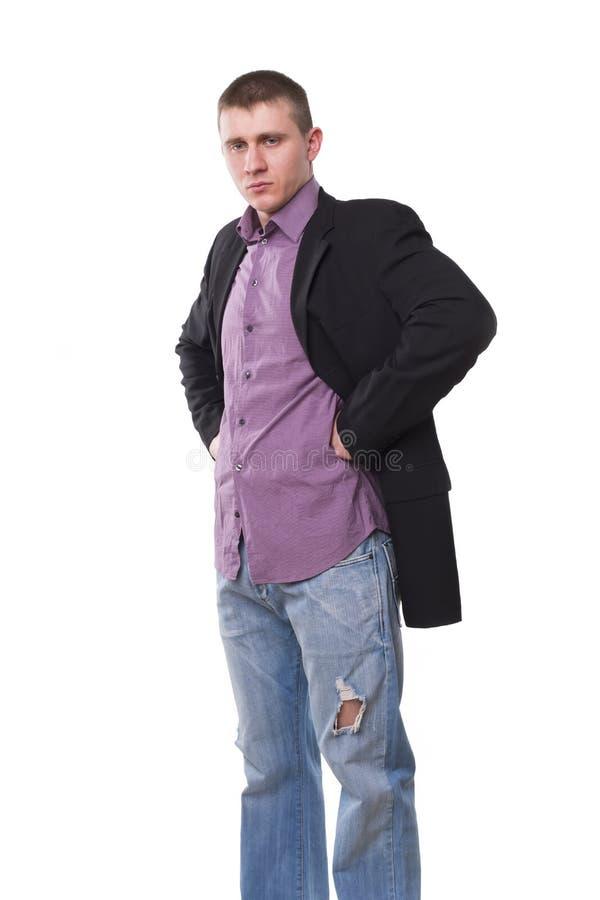 Homem novo em um revestimento e em calças de brim fotos de stock