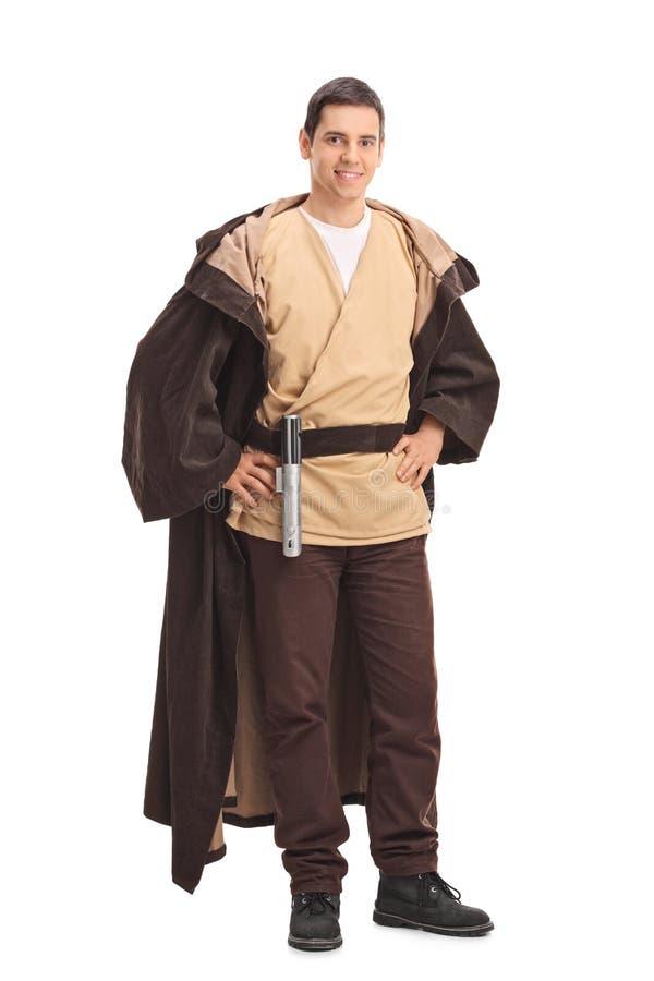 Homem novo em um traje do guerreiro fotos de stock royalty free
