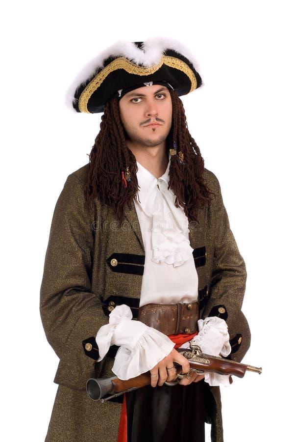 Homem novo em um traje do pirata fotografia de stock