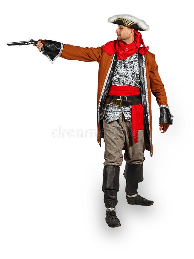 Homem novo em um traje do pirata com pistola fotos de stock