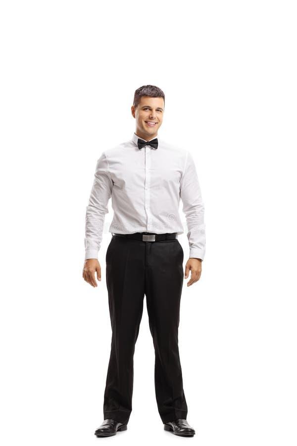 Homem novo em um tux imagem de stock
