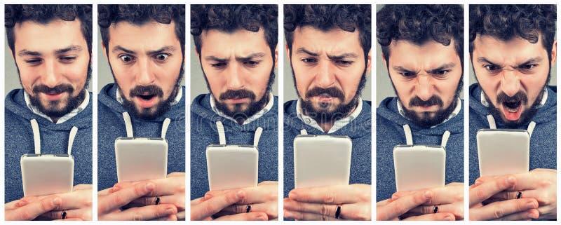 Homem novo expressivo que usa um smartphone fotografia de stock