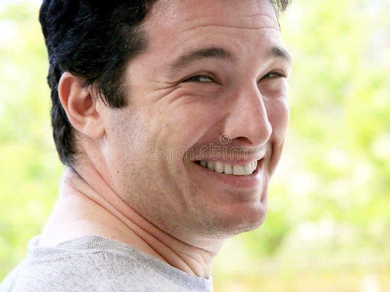Homem novo feliz ao ar livre imagem de stock royalty free