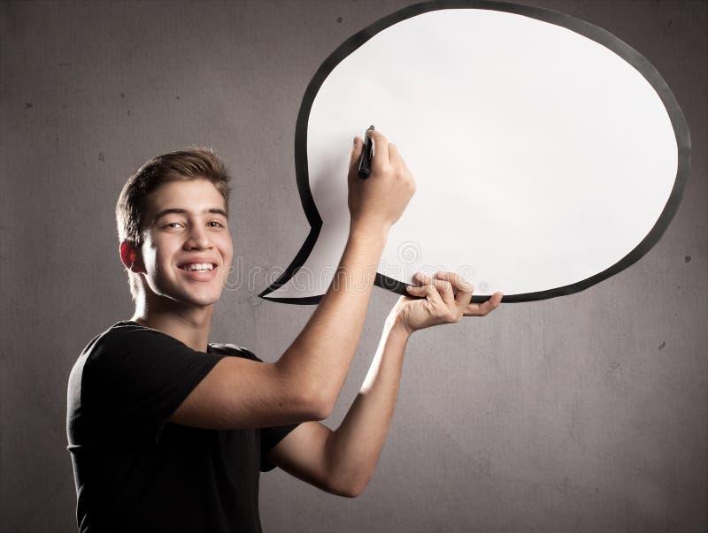 Homem novo feliz com bolha do discurso imagem de stock