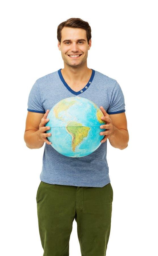 Homem novo feliz que guarda o globo fotografia de stock royalty free