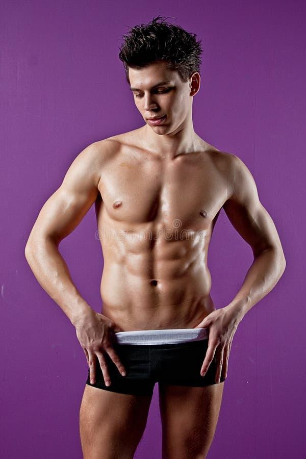 Homem novo molhado do músculo 'sexy' imagens de stock royalty free