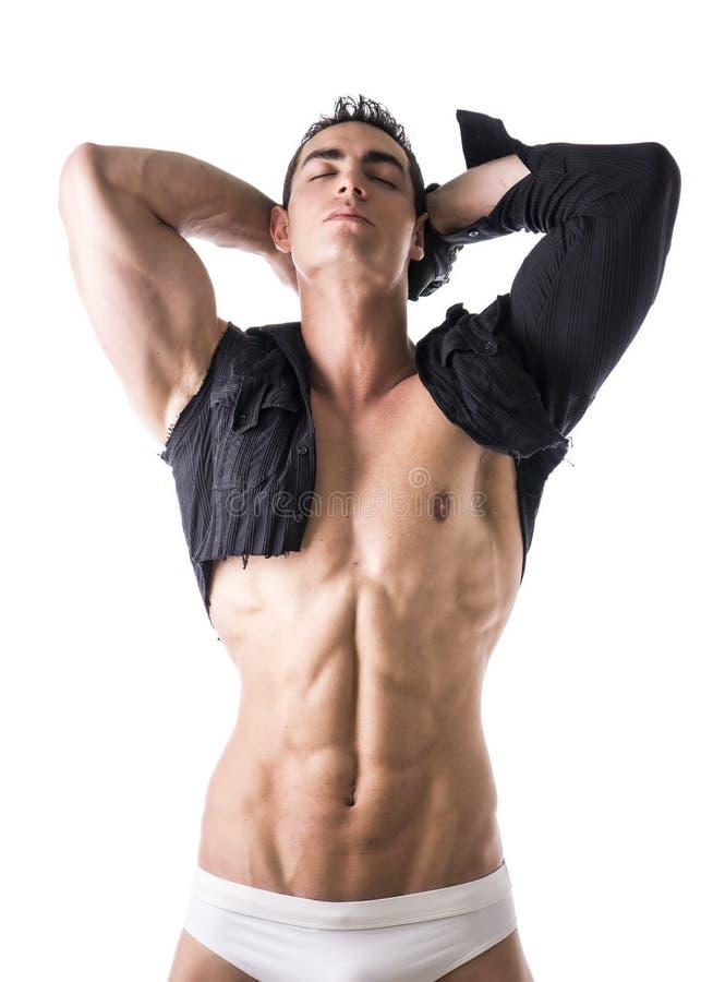 Homem novo muscular com a camisa único-sleeved no torso despido imagem de stock royalty free
