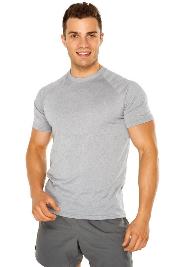 Homem novo muscular saudável isolado no branco imagem de stock royalty free