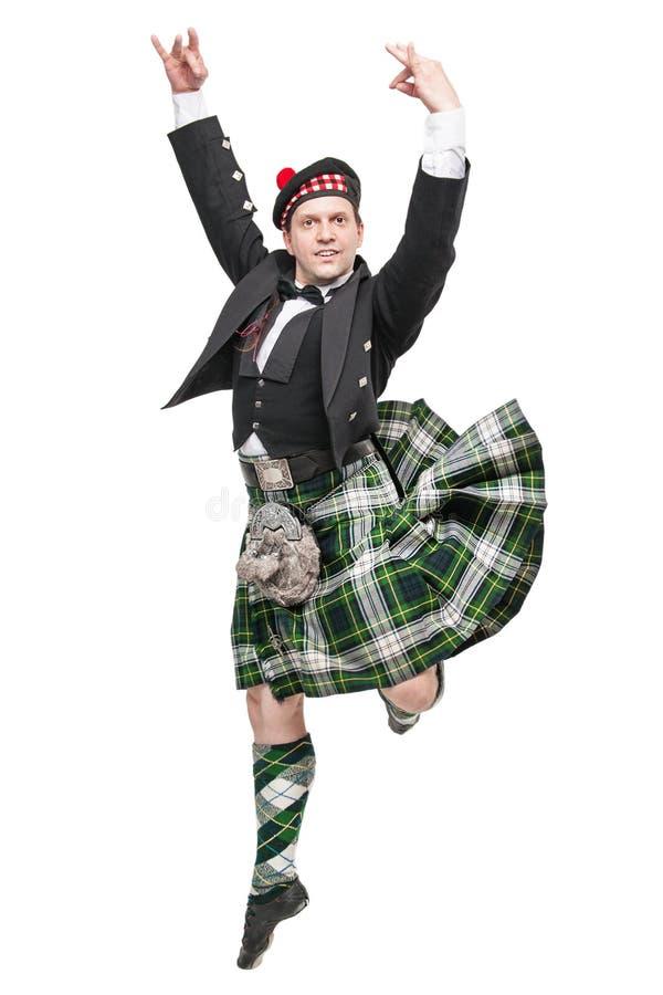 Homem novo na roupa para a dança do Scottish fotos de stock
