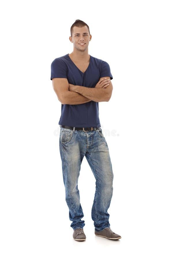 Homem novo nas calças de brim e no tshirt fotografia de stock