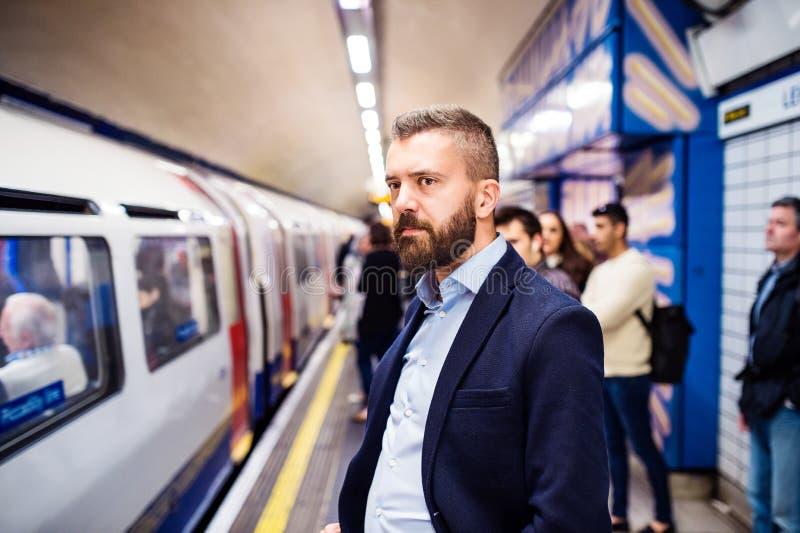 Homem novo no metro imagem de stock royalty free