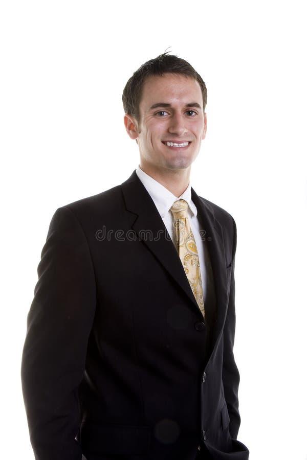 Homem novo no sorriso agradável do terno foto de stock