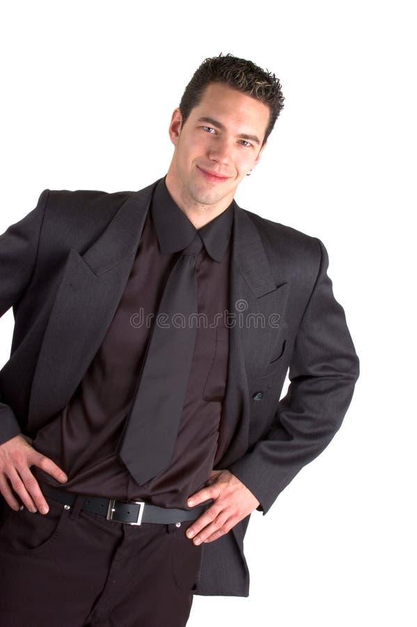 Homem novo no terno fotografia de stock royalty free