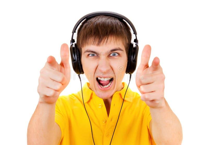 Homem novo nos fones de ouvido fotos de stock