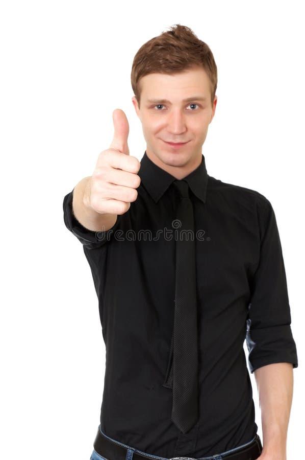 Homem novo ocasional feliz que mostra o polegar acima imagens de stock
