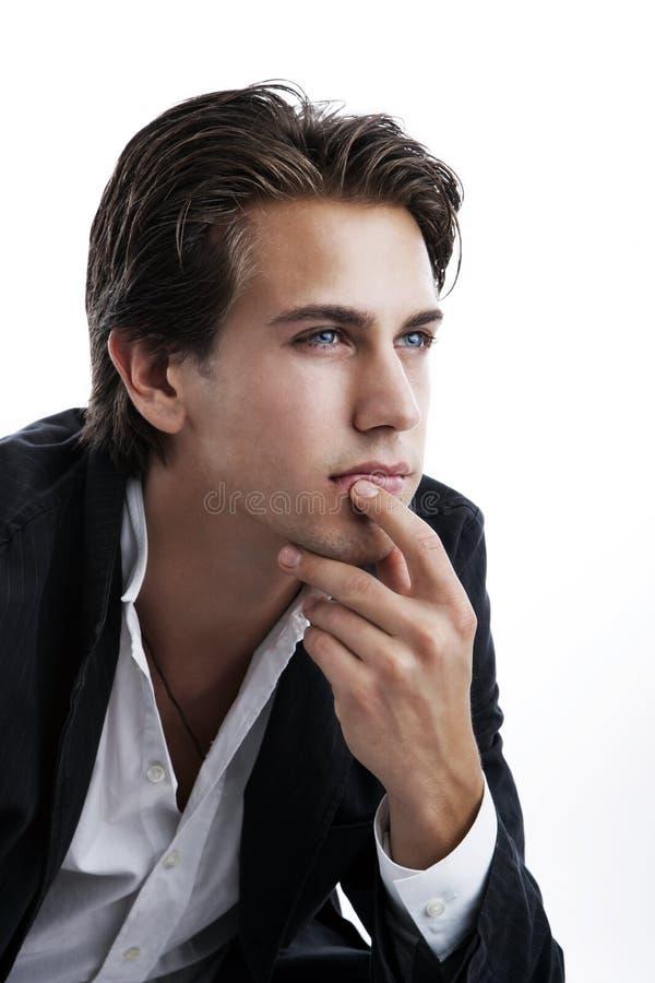 Homem novo pensativo fotografia de stock royalty free