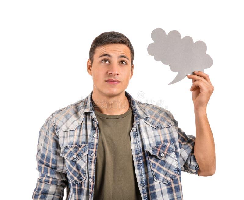 Homem novo pensativo com bolha do discurso no fundo branco imagem de stock