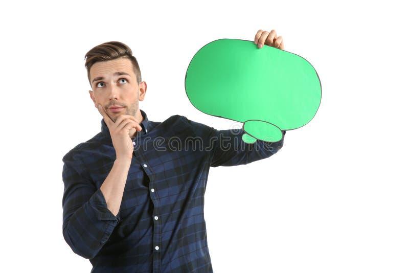 Homem novo pensativo com bolha do discurso no fundo branco fotografia de stock royalty free