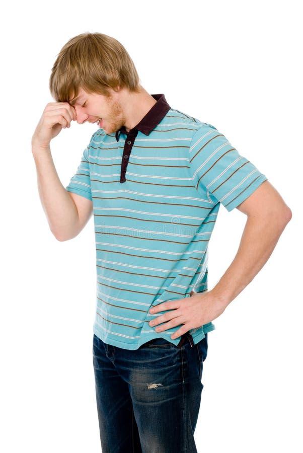 Homem novo pensativo em uma pose de um pensador foto de stock