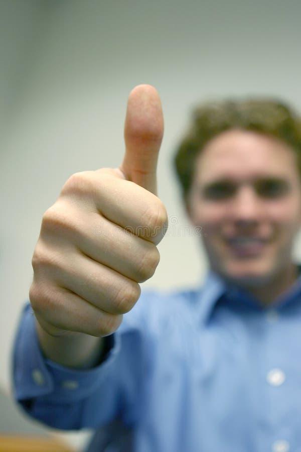 Homem novo - polegar ACIMA imagens de stock royalty free