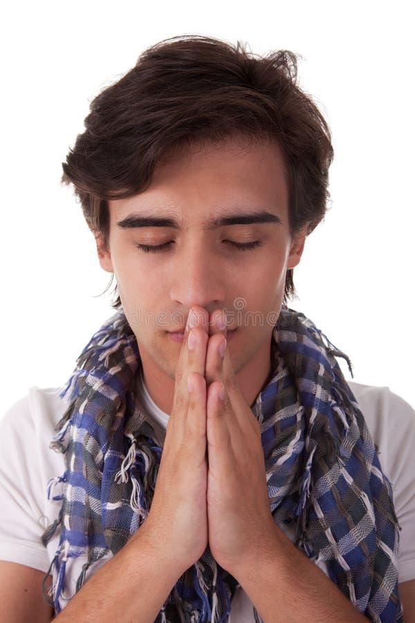 Homem novo Praying imagens de stock royalty free