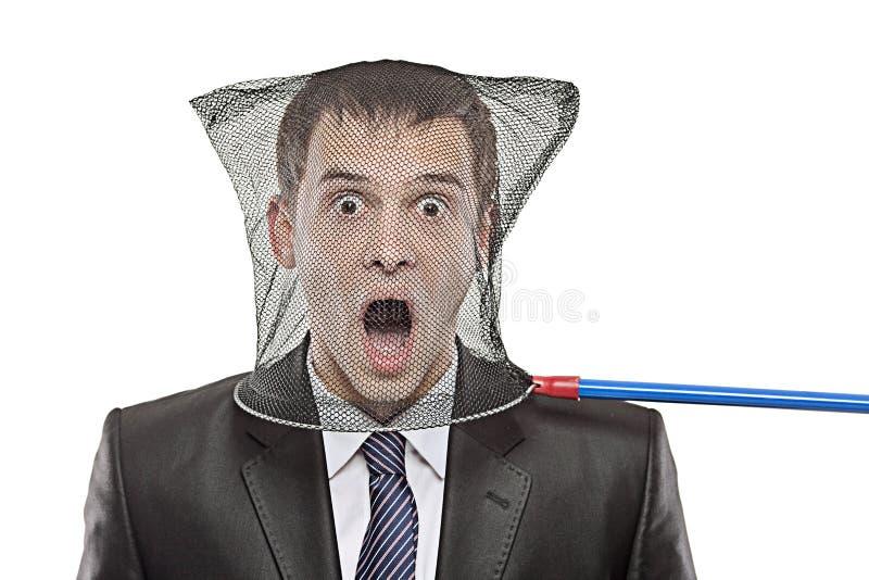 Homem novo prendido em uma rede da borboleta imagem de stock