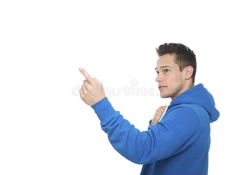 Homem novo que aponta com dedo imagem de stock royalty free