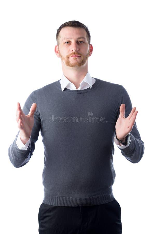 Homem novo que guarda algo entre suas mãos fotografia de stock