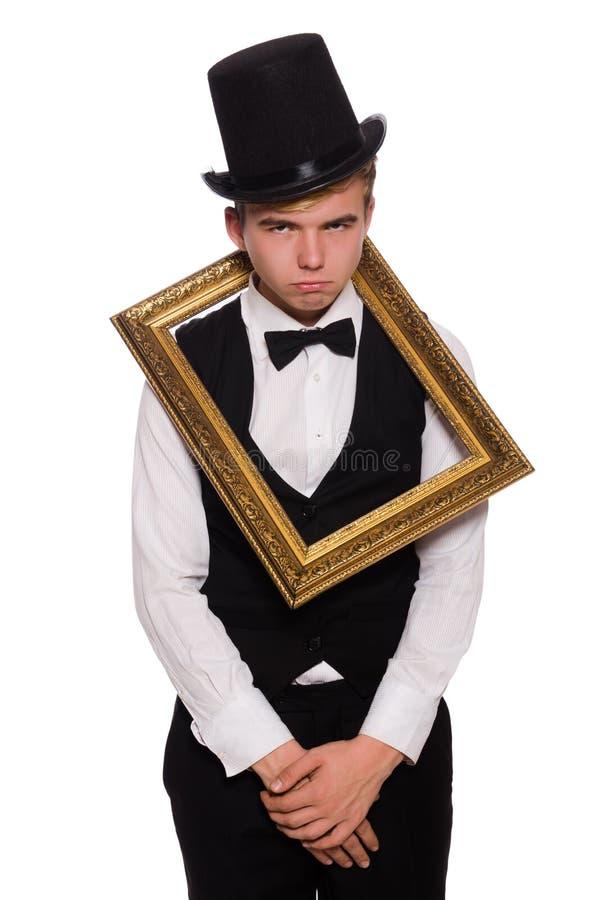 Homem novo que guarda o quadro foto de stock