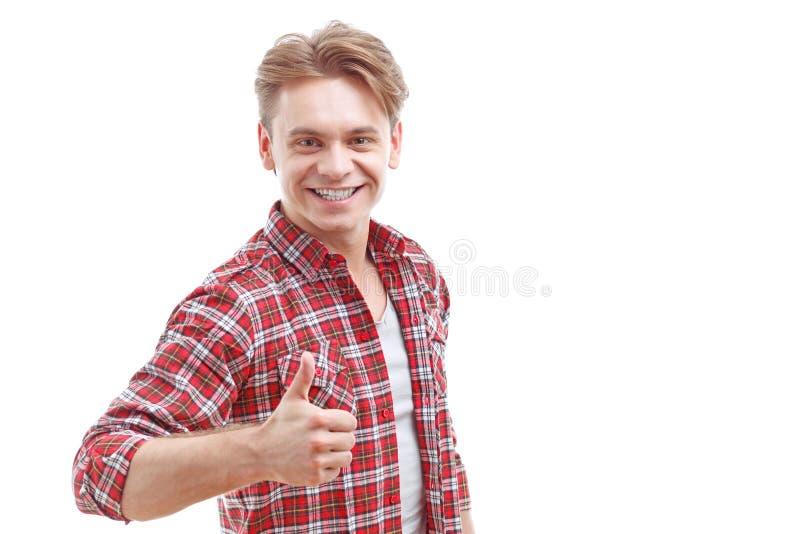 Homem novo que manuseia isolado acima no fundo branco imagem de stock
