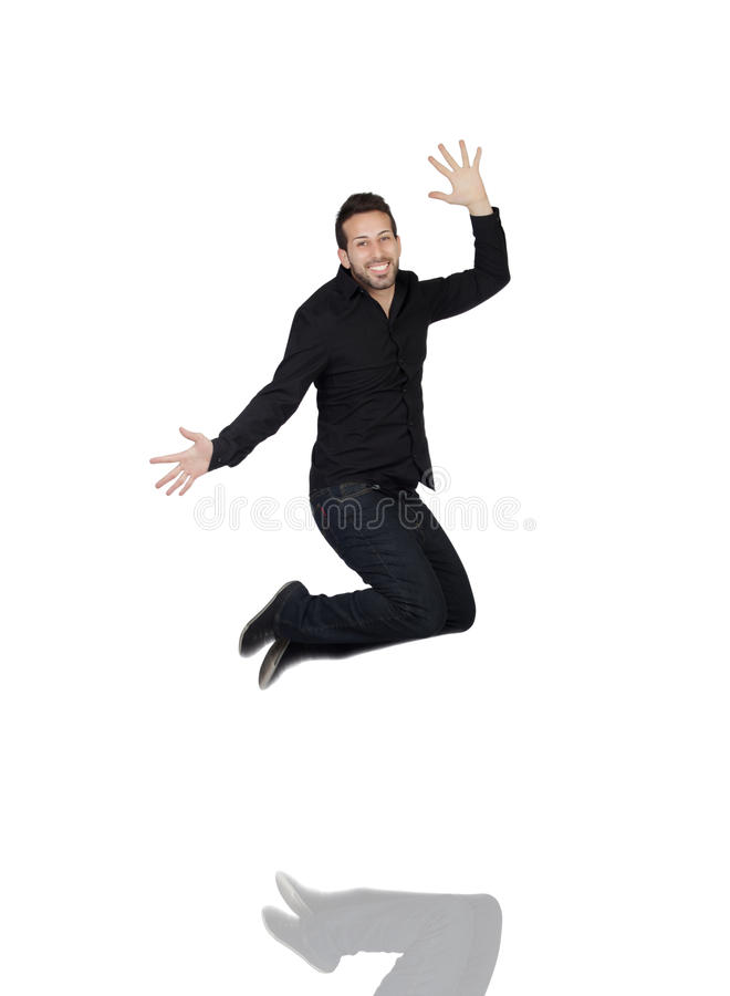 Homem novo que salta na alegria fotografia de stock