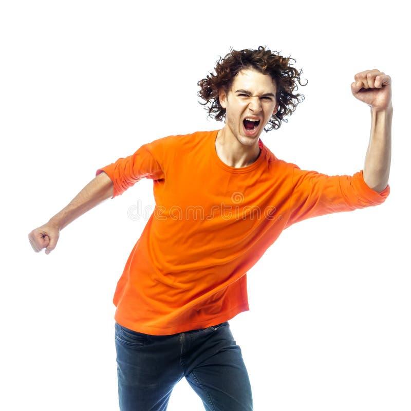 Homem novo que screamming o retrato feliz imagens de stock royalty free