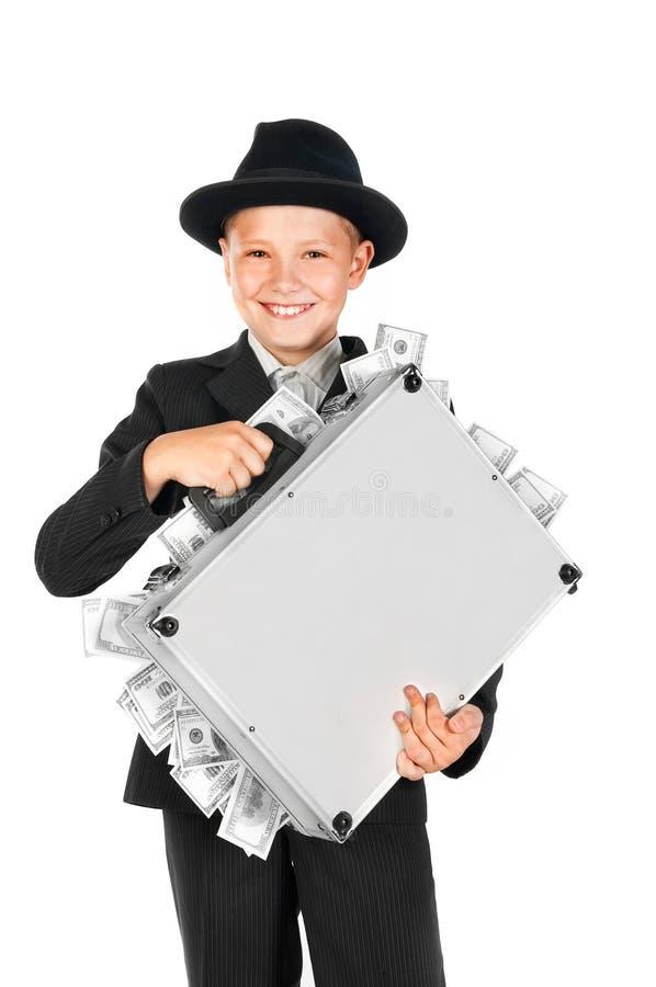 Homem novo rico que mantem uma mala de viagem completa dos dólares imagem de stock royalty free