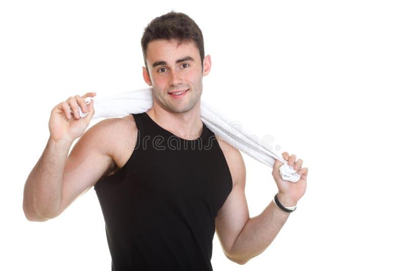 Homem novo saudável com a toalha isolada foto de stock