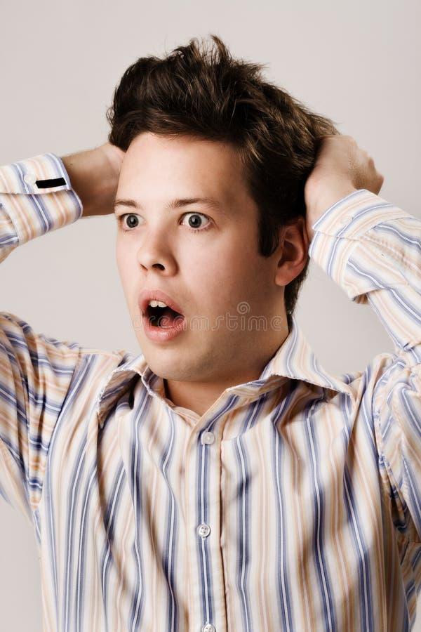 Homem novo scared imagens de stock royalty free