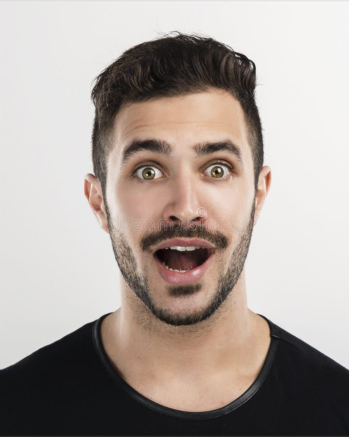 Homem novo surpreendido fotografia de stock