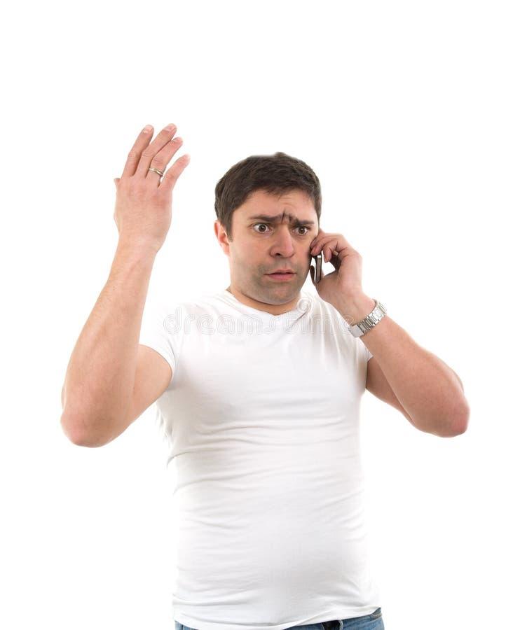 Homem novo triste com telefone imagens de stock