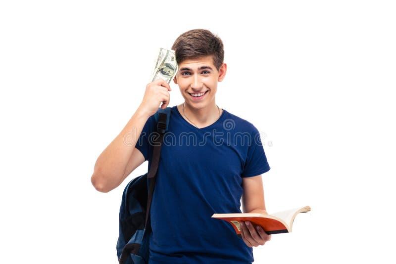 Homem ocasional feliz que guarda o livro e o dinheiro fotos de stock royalty free