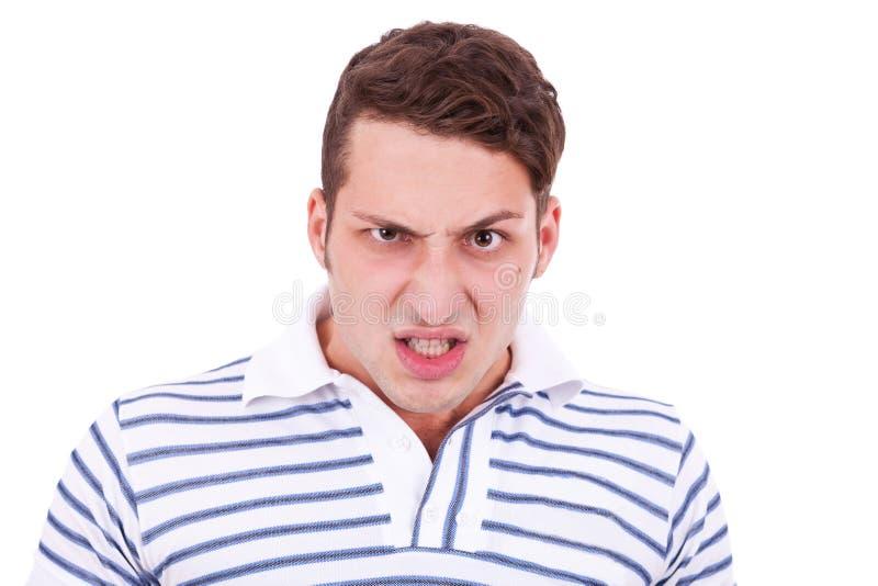Homem ocasional novo irritado fotografia de stock royalty free