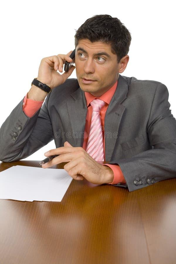 Homem ocupado no escritório fotografia de stock royalty free