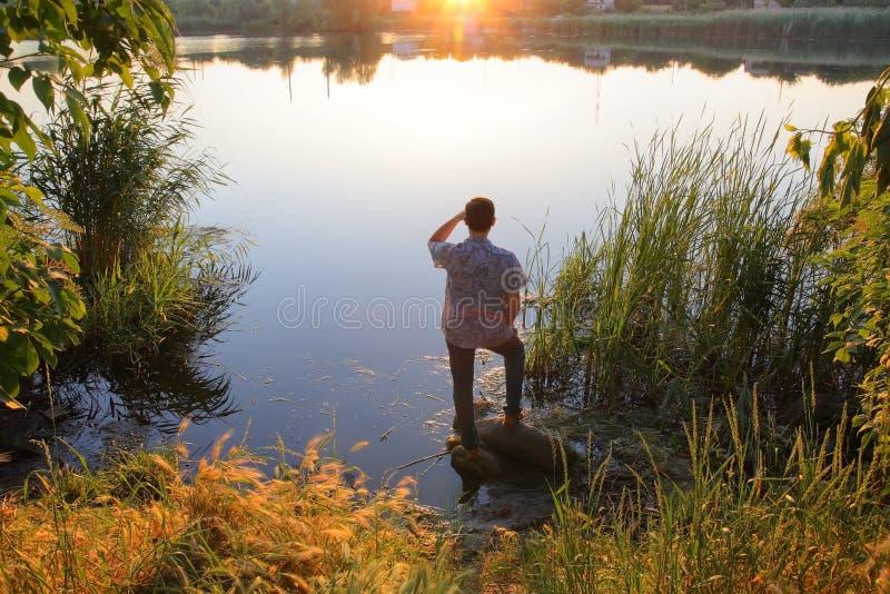 Download Homem pelo rio foto de stock. Imagem de praia, against - 12808792