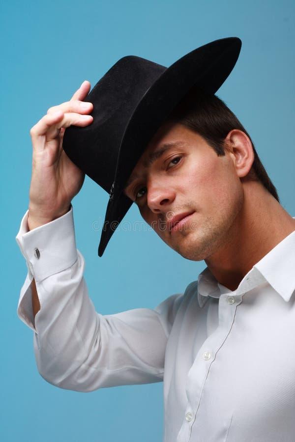 Homem pensativo com chapéu imagem de stock