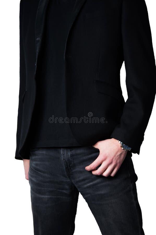Homem principal colhido no blazer preto com m?o no bolso das cal?as de brim fotografia de stock royalty free