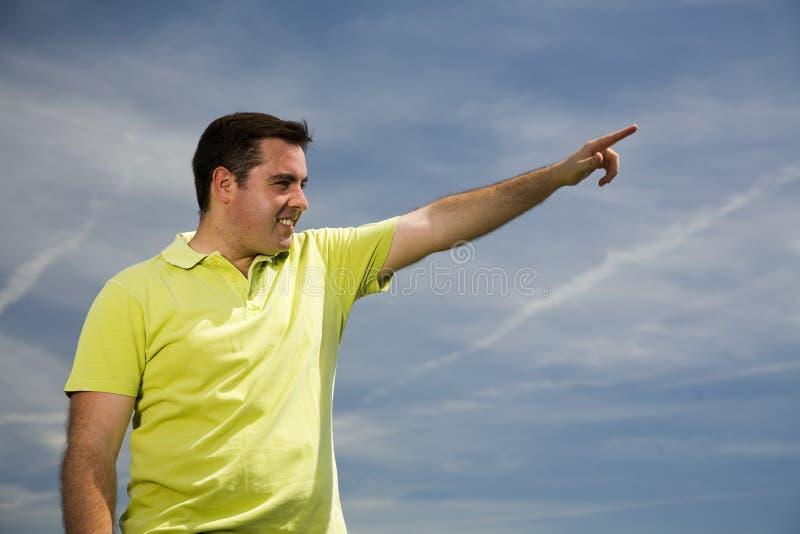Homem que aponta para a frente fotografia de stock